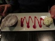 Warm cherry-chocolate cake and vanilla ice cream.