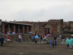 Somehow seeing Pompeii in the rain makes it more real, more sad. The only color was from umbrellas and ponchos.
