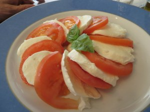 Ric chose a classic insalata caprese knowing full well he'd get some of my pizza. He got some of Jane's, too.