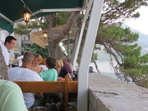 Across from the restaurant building, lining the seawall, are tables-with-a-view.