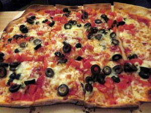 Ric's pizza, simply black olives and peperoncini. They were out of arugula.
