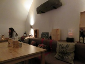 Indoors, serene, a little cave-like, but cozy.