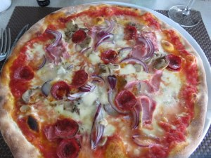 My pizza with red onions, prosciutto, salame piccante, and mushrooms was good, but actually the prosciutto was over-the-top and could have been left off.