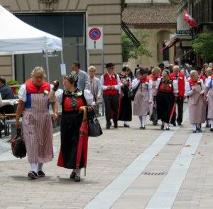 The choral groups from Germany were quite a colorful invasion.