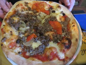 Ric's pizza with minced beef (not done in Italy), onions and marinated red peppers.