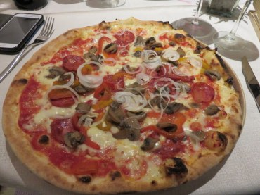 I cannot remember the name of my pizza! Spicy salame, mushrooms, peppers, and onions. Not really a classic in Italy but tasty.