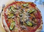 Pizza Zio Alfonso: zucchini, corn, peas, walnuts, mushrooms, prosciutto, tomato and mozzarella.
