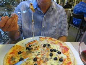Ric's pizza Romana with anchovies, capers and olives. Very much a standard in Italy.