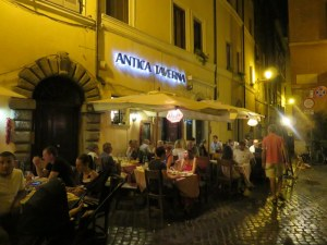 Antica Taverna's golden glow. It's away from the Piazza Navona hordes so you have to want to find it.