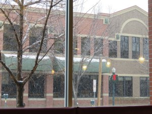Large windows allowed us to watch the falling snow.